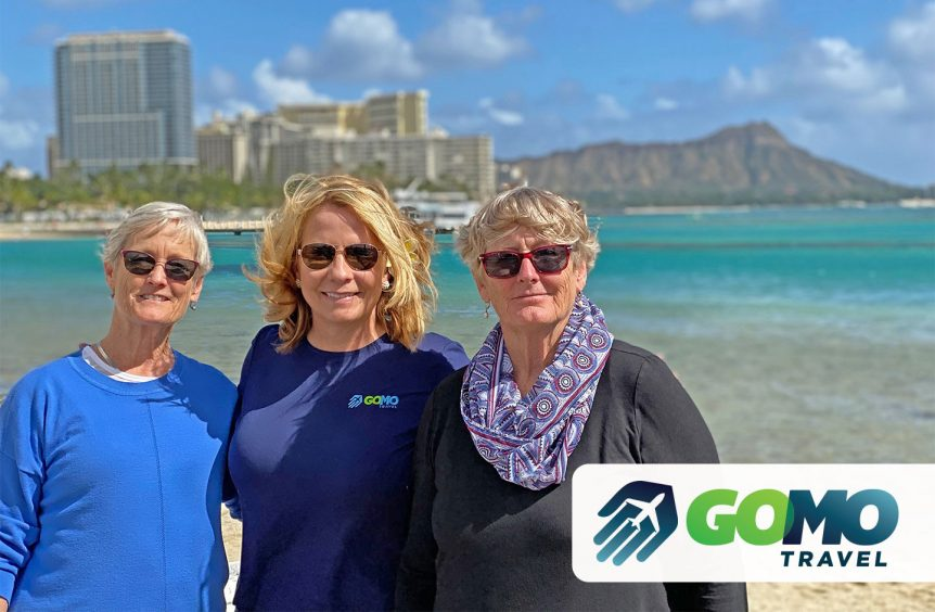Kerri Johnson posing with happy clients with ocean and city skyline in the background